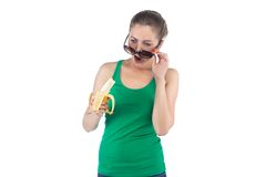 Photo surprised woman with banana and sunglasses Royalty Free Stock Photos