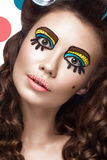 Photo of surprised young woman with professional comic pop art make-up and design manicure. Creative beauty style. royalty free stock images