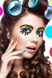 Photo of surprised young woman with professional comic pop art make-up and design manicure. Creative beauty style. royalty free stock photography