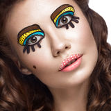 Photo of surprised young woman with professional comic pop art make-up and design manicure. Creative beauty style. Stock Images