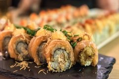 Sushi rolls - Japanese food in restaurant. Photo of sushi rolls - Jjapanese food in restaurant - close-up image royalty free stock photos