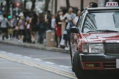 Hong Kong Taxi Cab. Photo of symbolic hong kong taxi cab on the streets of Hong Kong royalty free stock photography