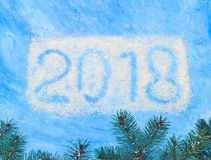 Symbols 2018 written on a blue background. Photo of symbols 2018 written on a blue background Stock Photo
