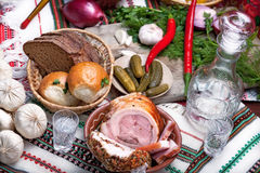 Photo of a table top full of vegetables, pork belly, bread and other foods Stock Photos