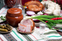 Photo of a table top full of vegetables, pork belly, bread and other foods Royalty Free Stock Images