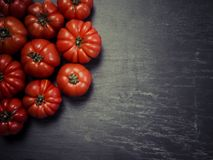 Marmande tomatoes on slate background Stock Image