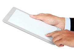 Photo of a tablet held by a hand of businessman vertically Stock Images