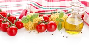 Photo of tagliatelle with cherry tomatoes,basil,oil,garlic at the top on white Royalty Free Stock Photos