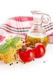 Photo of tagliatelle pasta with cherry tomatoes at the top on white Stock Images