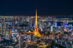 This photo take from Roppongi hills view point. Tokyo Tower and colorful night light from the buildings with highlight and shadow in the dark night sky Tokyo royalty free stock photo