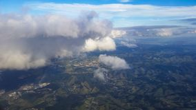 Photo taken from Aircraft Brazil from above. Dirt roads, asphalt, forest, forest, smoke, river, look of a plane stock photo