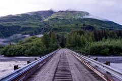 Empty Bridge with look towards mountain covered in clouds in Ala stock photo