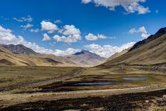 Peru Andes Mountain Scene blue Sky and Clouds stock photo