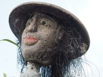 Closeup of a scarecrow in a rice field in Bali, Indonesia. Photo taken in August 2018 in a rice field in Bali, Indonesia. This is a close up of the head of this royalty free stock photo
