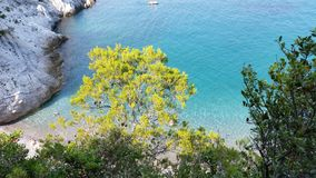 Small beach of Bergeggi seen from a path in Liguria stock photos