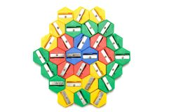 A bunch of multiple colored pencil sharpeners. A photo taken on a bunch of multiple colored hexagonal shaped pencil sharpeners against a white backdrop. They are Stock Image