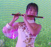 Actress playing the flute in chengdu,china royalty free stock photos