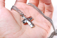 Crucifix Necklace In Hand Royalty Free Stock Photography