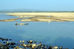 Boatman and the river. Photo taken form Shomesshor nod, Birishirim Bangladesh royalty free stock images