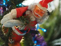 Santa Claus, light string, play of light in an in a fir tree stock photography