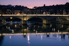 Sunset on an ancient bridge of Rome, Italy royalty free stock images