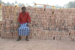 taking rest portrait of a brick field labour at hooghly west bengal india