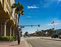 Walk on the street of the city. Photo taken in January 2016. This street is located in the city of Daytona Beach, Florida. It was a beautiful sunny day, the sky royalty free stock images