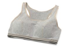 A light grey colored sports brassiere. A photo taken on a light grey colored sports brassiere against a white backdrop royalty free stock photo