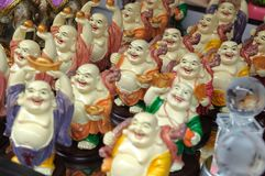 Figurines of Laughing Buddha. A photo taken on many figurines of the Laughing Buddha statue on display. The Laughing Buddha brings luck and good fortune Royalty Free Stock Photos