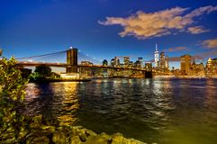 New York Skyline with Brooklyn Bridge Hudson River Manhatten Twi royalty free stock image