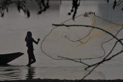 fisherman`s throwing fishing net at north 24 pargana west bengal india