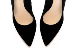 A pair of black pointed high-heeled shoes. A photo taken on a pair of black pointed three inches high-heeled shoes against a white backdrop Royalty Free Stock Photo