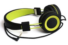 A luminous green and black wired headphone set. A photo taken on a pair of luminous green and black wired headphone set with adjustable slides against a white royalty free stock photos