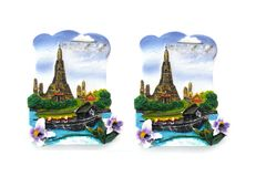A pair of fridge magnets with temple design by a river Royalty Free Stock Photo