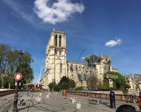 Notre Dame De Paris repaired by a crane with a lifting platform stock photography