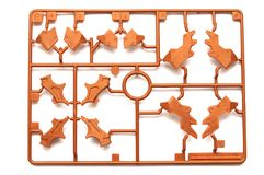 A piece of orange brown plastic scale model kit set with futuristic robotic parts royalty free stock photography