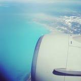 photo taken through a plane window over ocean Royalty Free Stock Photography