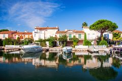 A pure luxury: Port Grimaud - a beautiful place near St. Tropez. Yachts and shiny water. Royalty Free Stock Image