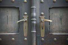 Photo taken in Prague. Black wooden door and golden handles royalty free stock photography