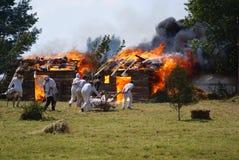 Grunwald, Poland - 2009-07-18: Burning huts royalty free stock photo