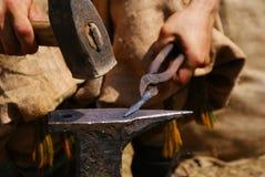 Grunwald, Poland - 2009-07-18: Blacksmith at work stock photo