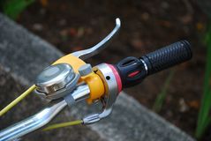Right Bicycle handle with handbrake and bell Royalty Free Stock Photography