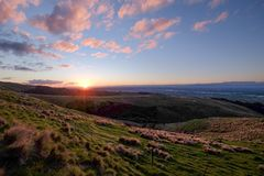 This photo is taken during road trip in New Zealand. It was approaching sunset and we drove to the top of the mountain. The view. Is excellent. The sky is very stock photography