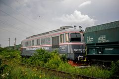 Photo taken in Romania on June 19, 2019. It is photographed an old locomotive that carries charcoal wagons.  royalty free stock photography