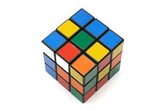 A Rubik`s cube against a white backdrop Stock Images