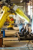 Welding robot in operation. Photo taken in Russia, in factory premises Royalty Free Stock Photography