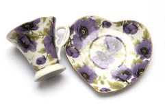 A set of tea cup and saucer with purple flora prints Stock Photo