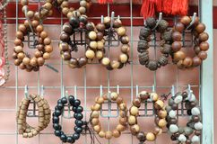 Hanging bracelets that are made of Mala beads. A photo taken on some bracelets that are made of Mala beads hanging on display stock photography