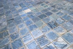 Blue Rough surface textured square tiles. A photo taken on some light blue rough surface textured square tiles flooring Royalty Free Stock Photo