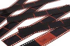 Photo film negatives. A photo taken on some photo film negatives against a white backdrop royalty free stock photos